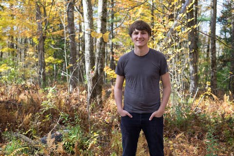 portrait of Oliver with dense woods in the background