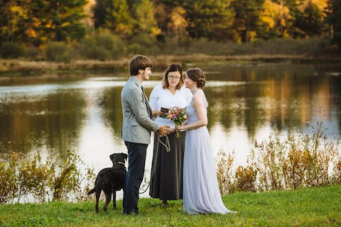 wedding scene: Jean and Oliver about to exchange vows in front of Sterling pond, with justice of the peace and Sapphie