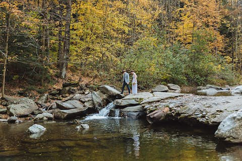 Jean and Oliver standing over a small waterfall on the Brewster river