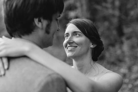 monochrome portrait of Jean looking at Oliver after the ceremony
