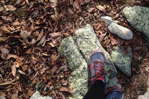 Looking down at Jean's trail running shoes